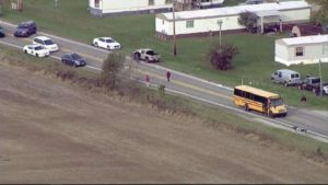 Driver dead, at least 7 kids hurt in bus accident in