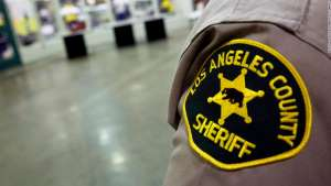 A Los Angeles County Sheriffs Department patch is seen on the shoulder of a deputy at the Los Angeles County Sheriffs Department Twin Towers Correctional Facility in Los Angeles, California, U.S., on Tuesday, Sept. 23, 2014. Conditions for mentally ill inmates in Los Angeles county have been a focus of federal probes since 1997, and the number with psychiatric disorders was an issue in a recent debate over a new jail. Photographer: Patrick T. Fallon/Bloomberg via Getty Images