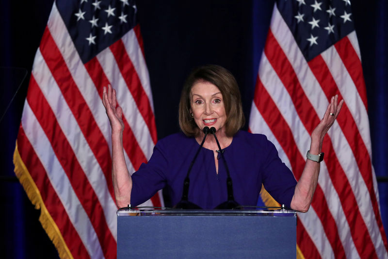 © Reuters. FILE PHOTO: U.S. House Minority Leader Nancy Pelosi reacts to U.S. midterm election results in Washington