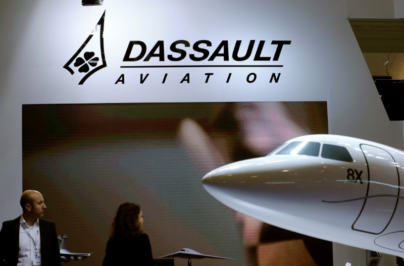 © Reuters. A Dassault Aviation logo is pictured on the company booth during the European Business Aviation Convention & Exhibition (EBACE) at Cointrin airport in Geneva