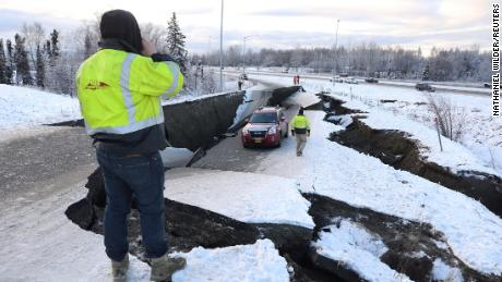 A stranded vehicle on a collapsed roadway near the Anchorage airport after the 7.0 earthquake.