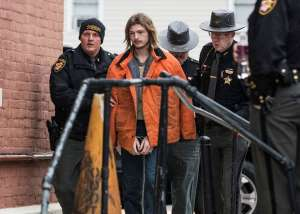 "a group of people standing next to a brick wall: Edward ""Jake"" Wagner, 26, of South Webster is escorted into the back of the Pike County Courthouse by police on Tuesday, November 27, 2018, in Waverly, Ohio. Jake Wagner is facing murder charges, along with his brother George Wagner IV and parents George ""Billy"" Wagner III and Angela Wagner, relating to the deaths of seven Rhoden family members and Hannah Gilley over a possible custody dispute. Jake Wagner is the father of Hannah Rhoden's older daughter and possibly her youngest child. The eight homicides took place in April of 2016 at four different homes, all around the same time, and it would spawn the largest homicide investigation in Ohio history. If convicted, all are facing the death penalty."