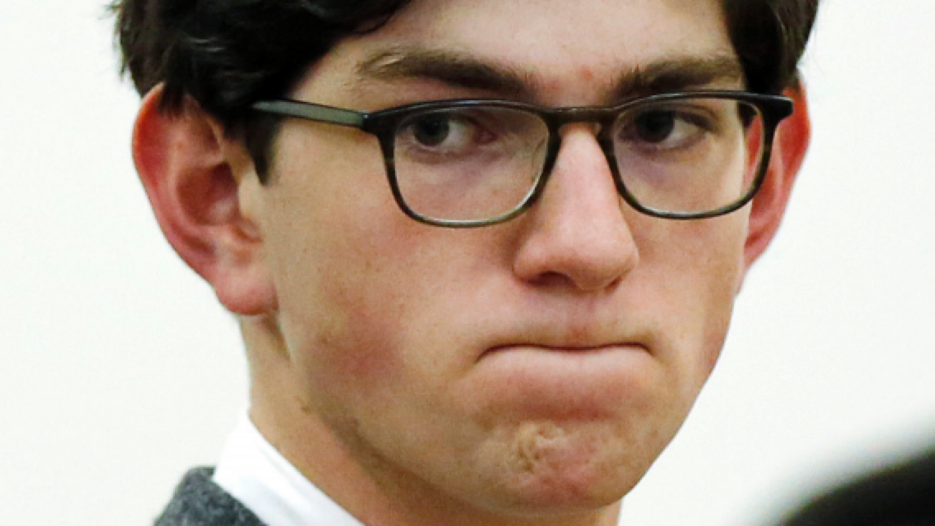 FILE - In this Oct. 29, 2015, file photo, Owen Labrie listens to prosecutors before being sentenced in Merrimack County Superior Court in Concord, N.H. He was convicted of sexually assaulting a younger prep school classmate in 2014 and was sentenced to jail. Labrie reported to the Merrimack County jail on Wednesday, Dec. 26, 2018, to begin serving the remaining 10 months of his jail sentence. (AP Photo/Jim Cole, Pool, File)