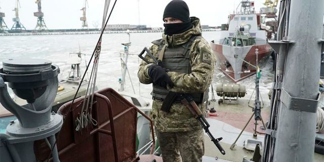 A Ukrainian serviceman stands onboard a coast guard ship in the Sea of Azov port of Mariupol, eastern Ukraine, on Dec. 3. The Ukrainian military has been on increased readiness as part of martial law introduced in the country in the wake of the Nov. 25 incident in the Sea of Azov, in which the Russian coast guard fired upon and seized three Ukrainian navy vessels along with their crews.