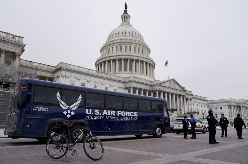 © Reuters. Air Force bus meant to transport Speaker of the House Pelosi and other members of Congress to flight to Afghanistan sits in front of Capitol in Washington