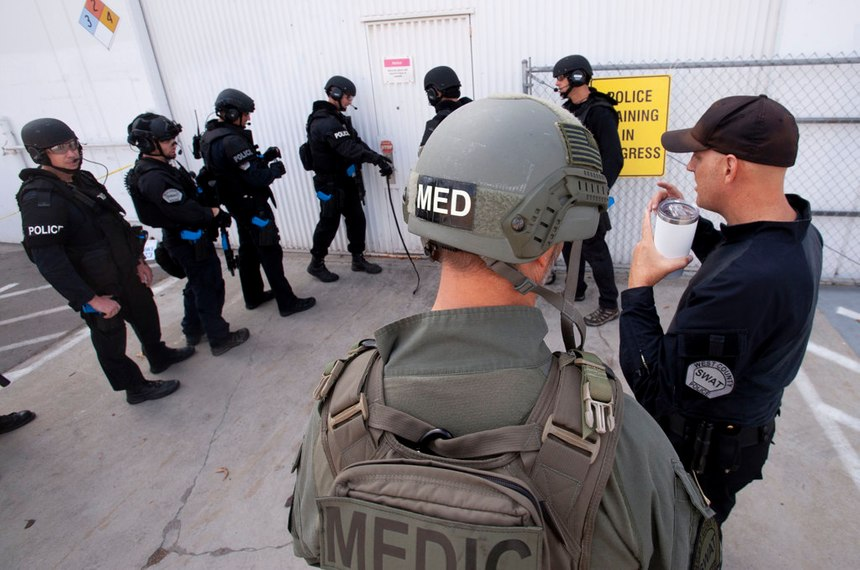 Dr. Joshua Bobko, right, walks back into a warehouse where West (Orange) County SWAT was holding a training exercise in Fountain Valley on Wednesday, October 16, 2019. (Photo/Paul Rodriguez)