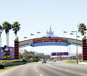 In this Jan. 31, 2017, file photo, cars travel one of the roads leading to Walt Disney World in Lake Buena Vista, Fla. (AP Photo/John Raoux, File)