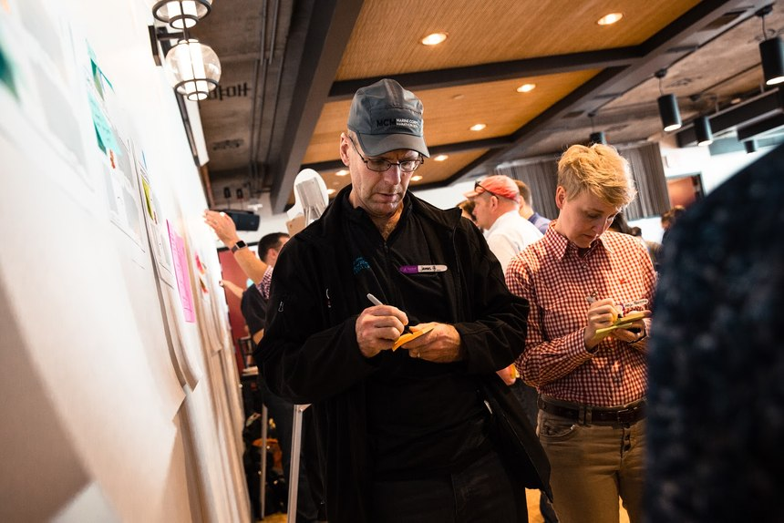 Brainstorming and interaction between participants is a key part of the design-thinking process. (Photo/Jim Gordon)