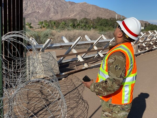 An Army Corps of Engineers soldier inspects existing a vehicle barrier and border fence near El Centro, CA, on May 7. (San Luciano Vera/Army)