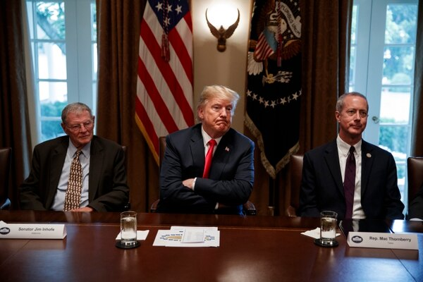 President Donald Trump (center) meets with Senate Armed Services Committee Chairman Jim Inhofe, R-Okla. (left), and House Armed Services Committee Chairman Mac Thornberry, R-Texas (right), at the White House on June 20, 2018.(Evan Vucci/AP)