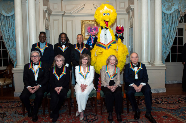 2019 Kennedy Center Honorees Michael Tilson Thomas, Linda Ronstadt, Sally Field, Joan Ganz Cooney, and Lloyd Morrisett, back row from left, Philip Bailey, Verdine White, Ralph Johnson, and characters from
