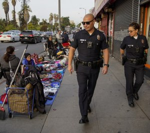 Officers in cities like Los Angeles are receiving training and resources to prepare them for interactions with immigrant communities where Spanish or English are not spoken. (Photo/TNS)