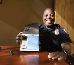 Chandler Police Commander Ed Upshaw shows the Ring kit, calling it a valuable tool in the fight against property and other crimes. (Photo/Pablo Robles/TNS)