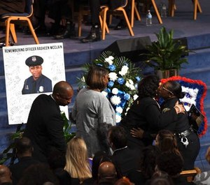 Hundreds of police officers were joined by civilians Friday at Officer Rasheen McClain's funeral. (Photo/TNS)