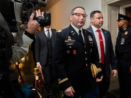 National Security Council aide Lt. Col. Alexander Vindman, left, leaves Capitol Hill on Nov. 19, 2019, at the end of a public impeachment hearing on President Donald Trump's efforts to tie U.S. aid for Ukraine to investigations of his political opponents. (Manuel Balce Ceneta/AP)