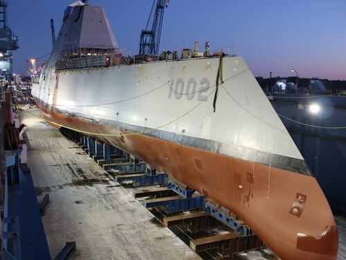The future guided-missile destroyer Lyndon B. Johnson was made ready before flooding of the dry dock at General Dynamic-Bath Iron Works shipyard on Dec. 9. The third Zumwalt-class destroyer was christened on Saturday. (General Dynamics-Bath Iron Works)