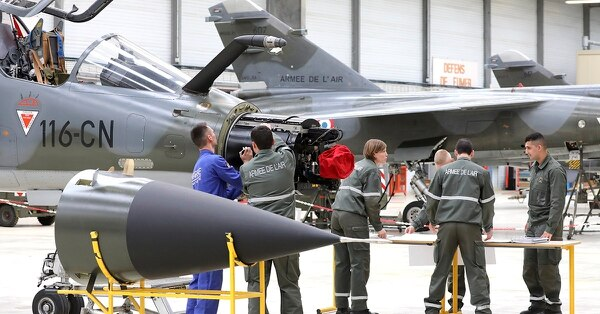 Military students stand by Mirage F1 fighting jets at the mid ranking Air Force officers' school,