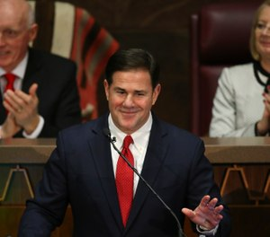 In this Jan. 13, 2020 file photo Arizona Republican Gov. Doug Ducey, foreground, gestures during his State of the State address. (Photo/AP)