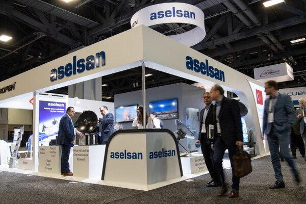 People walk past the Aselsan stand at Satellite2019 in Washington on May 6, 2019. The Turkish company has had its Hisar-A air defense system cleared by the country's military procurement office. (Nicholas Kamm/AFP via Getty Images)