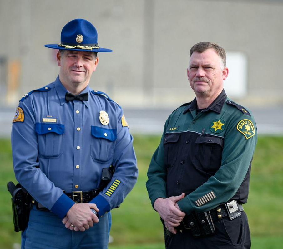 State Patrol Capt. Scott McCoy (left) and Skagit County Undersheriff Chad Clark stand near the section of Highway 20 they hope will be named after Trooper Thomas Hendrickson. (Photo/TNS)